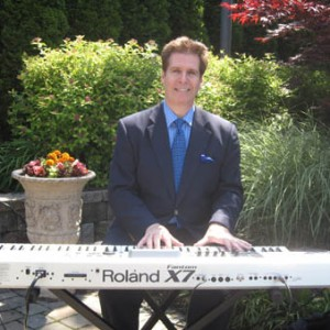 Arnie playing his Roland X7 keyboard for an outdoor New Jersey wedding ceremony