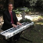 Arnie-performing-at-an-outdoor-wedding-in-north-Jersey-300x225
